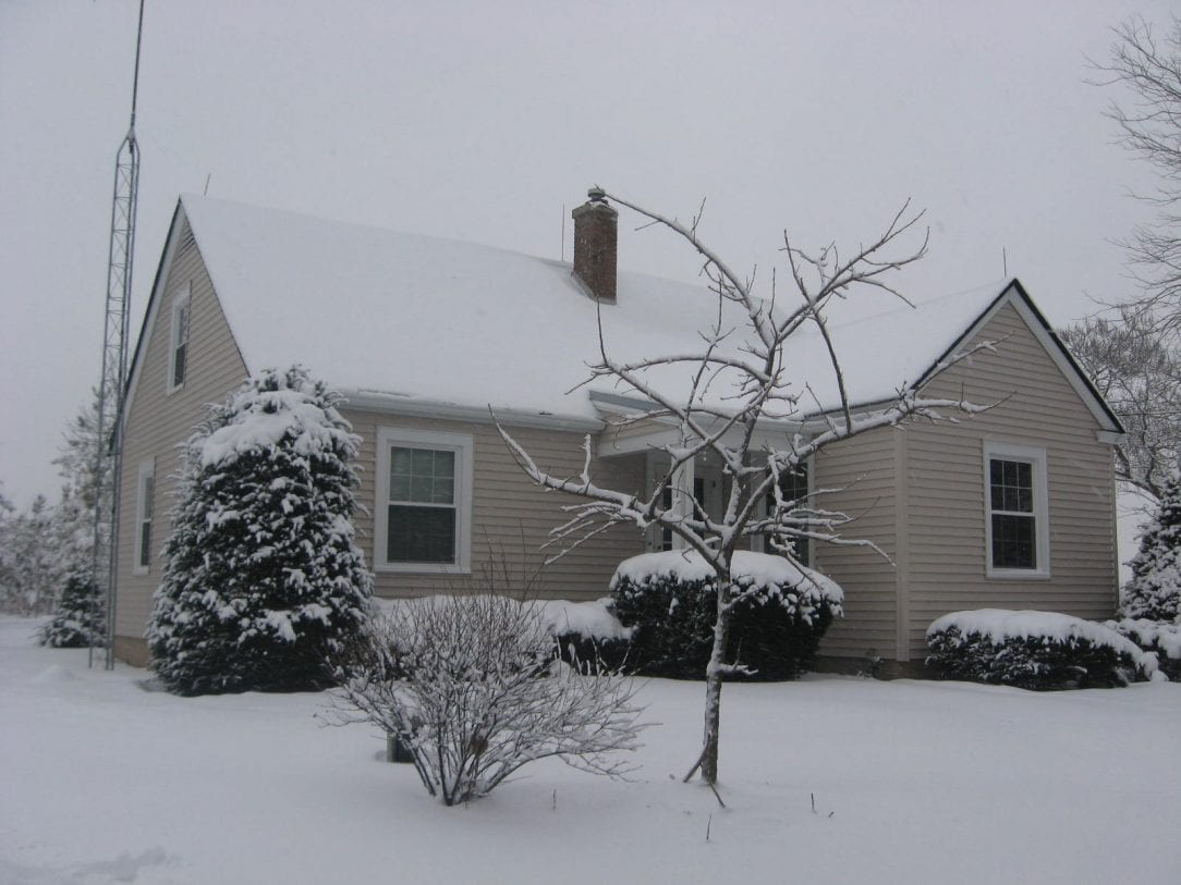 snow covered house -#main