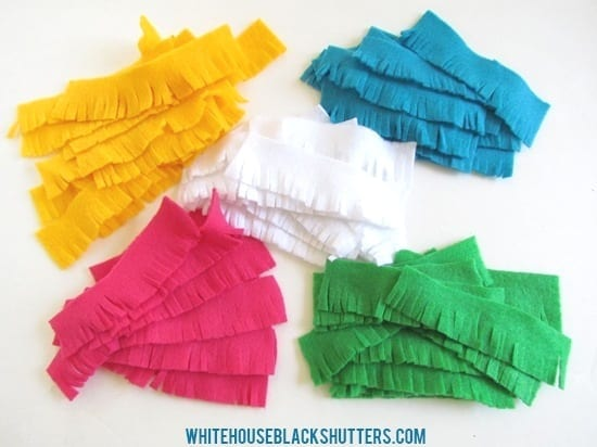 make a Pinata wreath out of felt for Cinco de Mayo! via @whbsblog