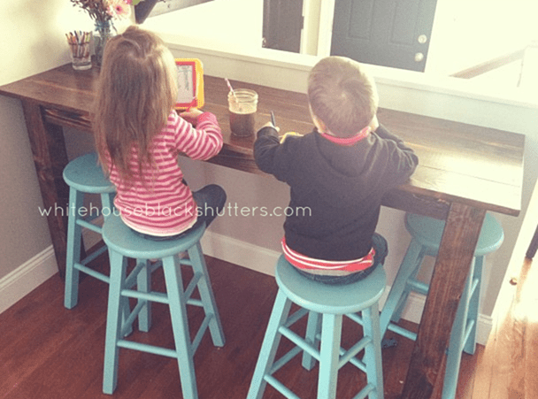 whitehouseblackshutters.com: 77 year old floor boards were upcycled to make this rustic, family breakfast bar!