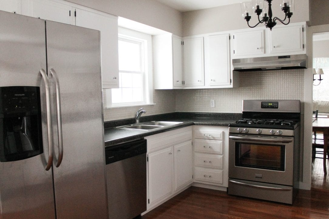 by reusing items and waiting patiently, this kitchen only cost $2500 to renovate. WOW!