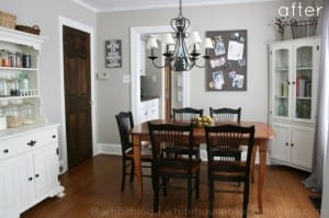 beautiful, neutral dining room with warm grey walls and white thick trim.