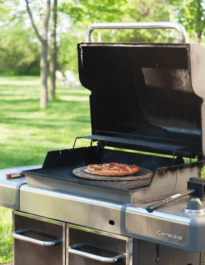 how to grill a frozen pizza, perfect for summer so you don't heat up the house!