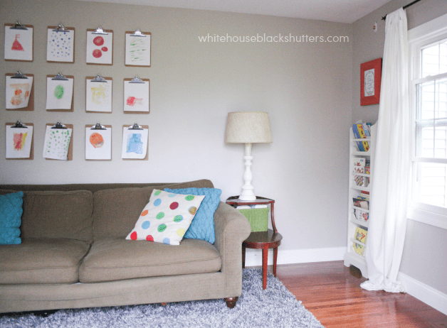 I love this idea for hanging kids' artwork - a clipboard wall! Cheaper than frames and easy to switch out.