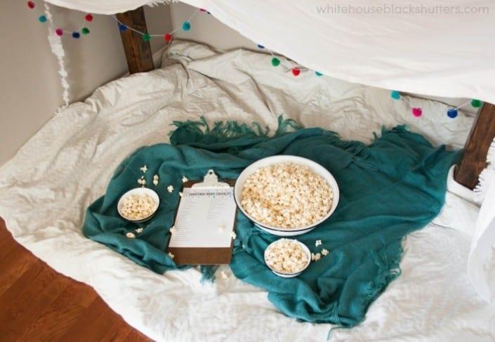 tips to create the perfect movie night plus a printable Christmas movie checklist.