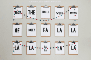 deck the walls with this DIY Christmas Carol art! Even shows how to make a clipboard wall.