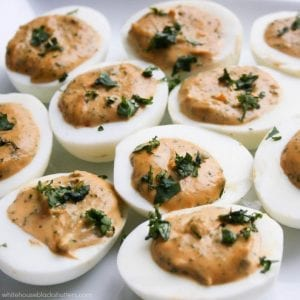 Sriracha Deviled Eggs? Oh my YUM! add sriracha to deviled eggs for a twist on the favorite appetizer.