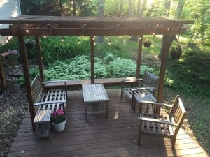 BEFORE - colorful outdoor space makeover using thrifted furniture, globe lights, and vivid pillows