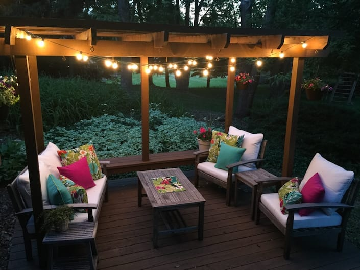 Colorful outdoor living space makeover before colorful outdoor space makeover using thrifted furniture globe lights and vivid pillows workwithnaturefo