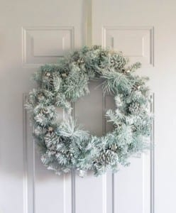 snowy, flocked update for a tired looking wreath using spray paint and a secret ingredient.