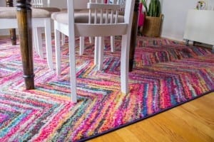 All the heart eyes for this colorful rug!