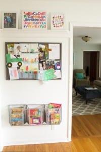 Kids artwork display, metal file baskets for books.