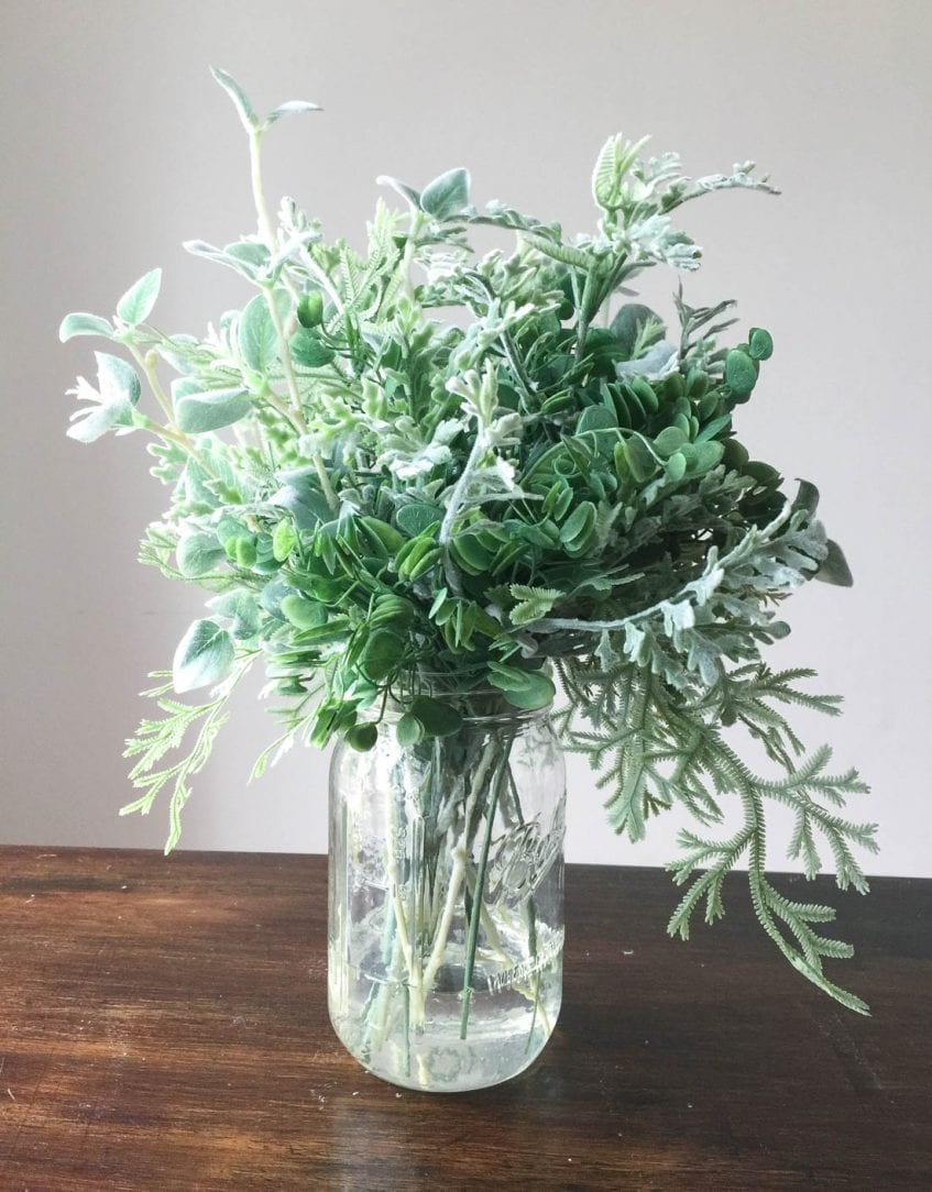 Realistic floral and greenery arrangement tips white