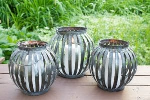 metal lanterns in a lush outdoor space