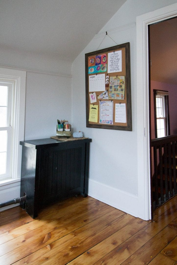 mini command center upstairs in a kids' bedroom with custom rustic bulletin board from Michaels