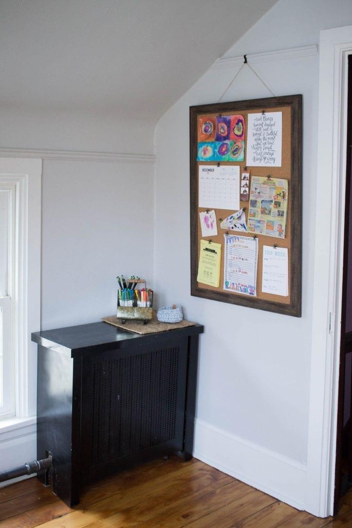 custom rustic bulletin board command center in a kids' room