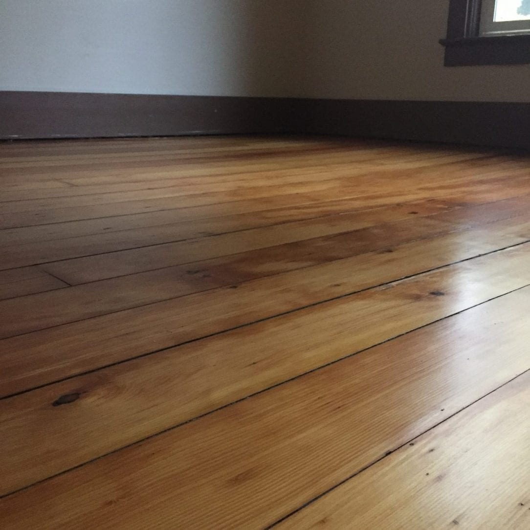 master bedroom pine flooring after refinishing