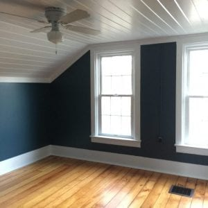 master bedroom work finished - dark walls pine flooring white planked ceiling