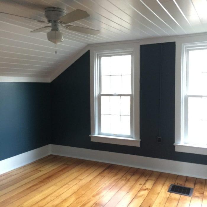 master bedroom work finished - dark walls pine flooring white planked ceiling