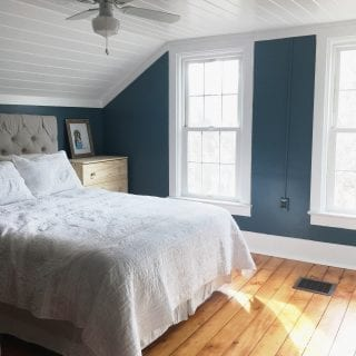 master bedroom makeover with dark walls and planked ceiling