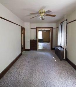 white house black shutters family room, before - dark trim, white walls